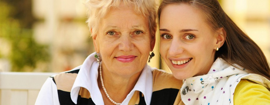 Mature woman and her granddaughter smiling