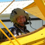 Smiling resident preparing for flight in biplane