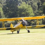 Biplane with propeller spinning about to take off