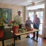Residents preparing for flower trimming class at the Fountains
