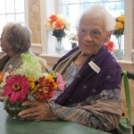 Shirley, a Fountains resident, with her flowers