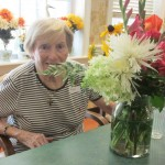 Ann, a resident of the Fountains, with her flower arrangement