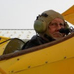 Close up of biplane pilot in cockpit