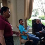 Fountains staff member enjoying conversation with students and resident