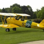 Biplane preparing for takeoff in grass