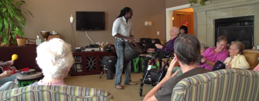 Drummer performing for group of Fountains residents