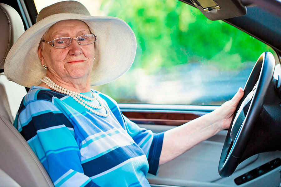Mature woman in driver's seat of car